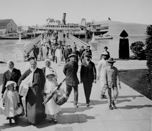 Historic photo of im mmigrants on Angel Island Pier